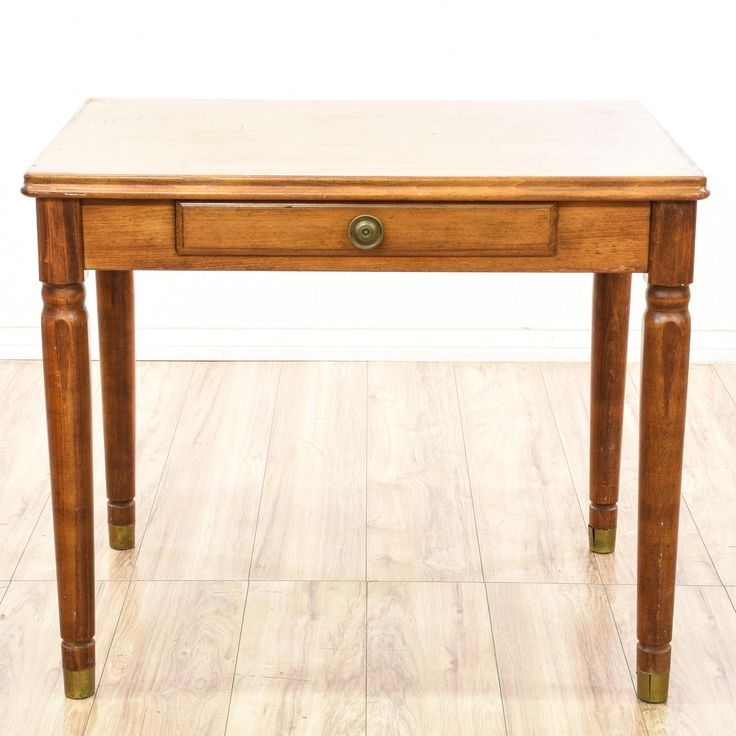 This small desk is featured in a solid wood with a rustic light cherry finish. This traditional console table has turned tapered legs, brass feet and 1 small drawer. Great for a small laptop workstation!  #americantraditional #desks #cornerdesk #sandiegovintage #vintagefurniture