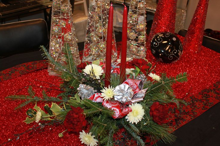 Holiday centerpiece start at Fantasy Flowers. Our designers are all about creating, candles, hurricanes, woodsy, vintage, traditional, classy..What does xmas decorations mean to you.