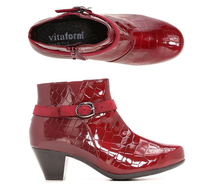 VITAFORM ELEGANCE Damenstiefelette Leder & Stretch Krokolack-Optik.Feminin und stilbewusst kommen diese Stiefeletten von VITAFORM ELEGANCE mit ihrem attraktiven Absatz daher. Ein Riemen mit Zierschnalle verleiht den Schuhen den letzten Schliff. Für den unübertroffenen Komfort, den Sie von VITAFORM gewohnt sind, sorgen ein Stretch-Keil und Schuhweite H.