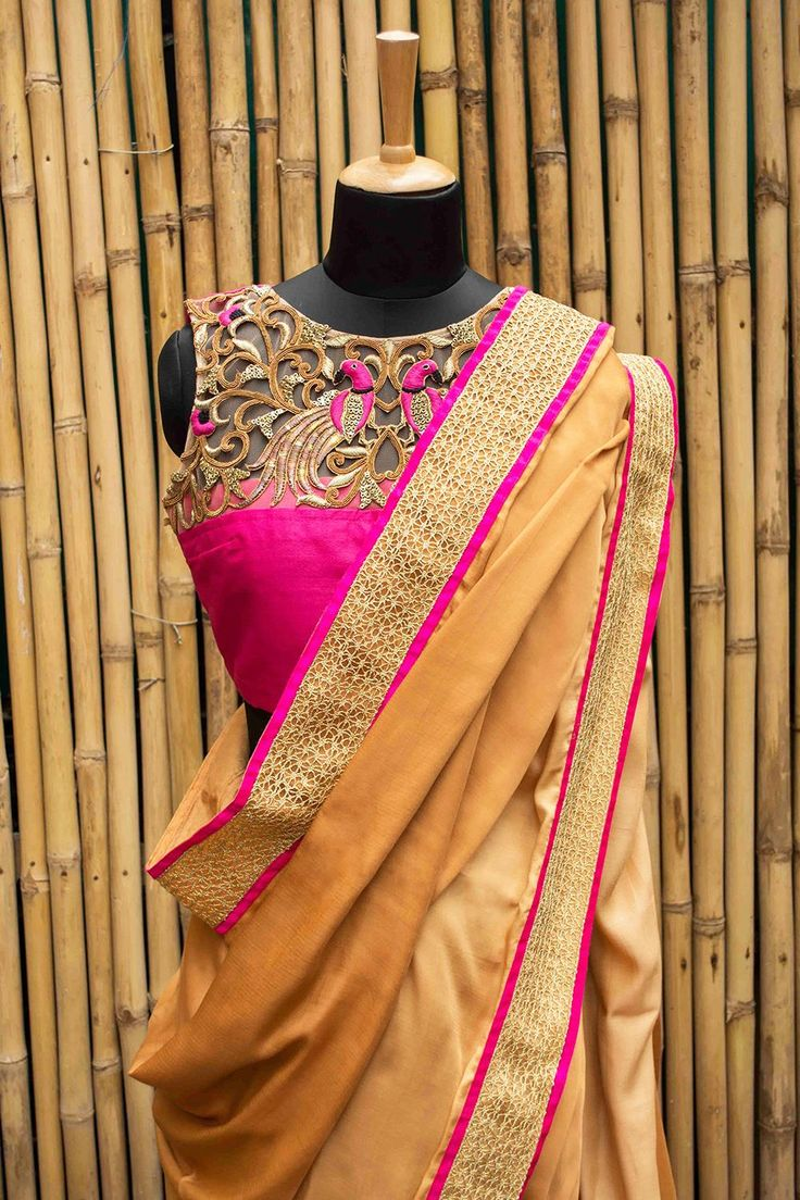 A multi tasking croptop saree blouse! Cropped with a rich cutwork yoke in gold pink. Indian fashion. Whatsapp +91 81050 68601. *Shipping worldwide* #saree #blouse #sareeblouse #blousedesigns #desi #indianfashion #india #bollywood #cutwork #pink