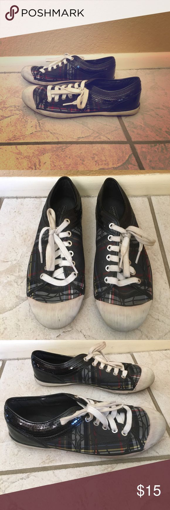 Coach Size 8.5 Tennis Shoes Coach tennis shoes in a multicolor plaid. These shoes are a size 8.5 and have been used. There is slight wear on the heel of the shoe and the white toe is scuffed. You could likely fix the toe of the shoe easily. Coach Shoes Sneakers
