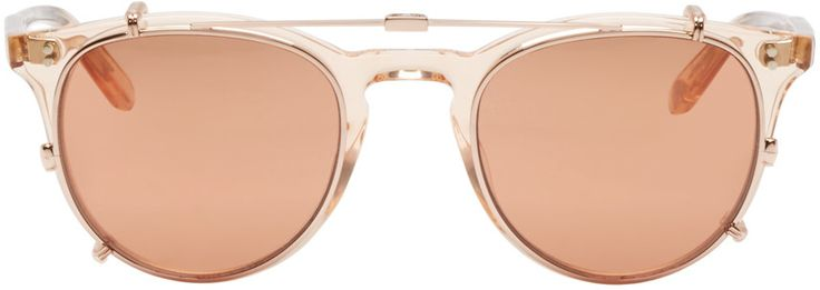 Hand-finished round acetate optical glasses in clear pink. Rose gold clip-on sunglasses with pink tinted polarized lenses.