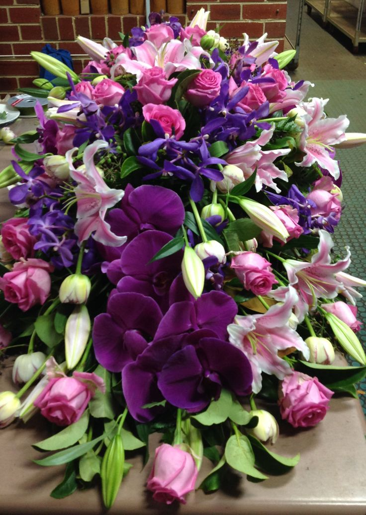 Purple and pink casket spray. #sympathyflowers #floraltribute. F11