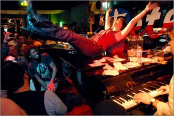 """Pete's Dueling Piano Bar in Dallas, Texas. """"One thing we can promise you is that a visit to Pete's will result in a night of extreme singing, clapping, and laughing. If your voice and hands aren't sore the next day, we haven't done our job!"""""""