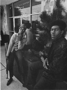 Little Bobby Hutton and Sherman Forte outside Oakland Jail, waiting for Bobby Seale to bail Huey out of Jail, 1967.
