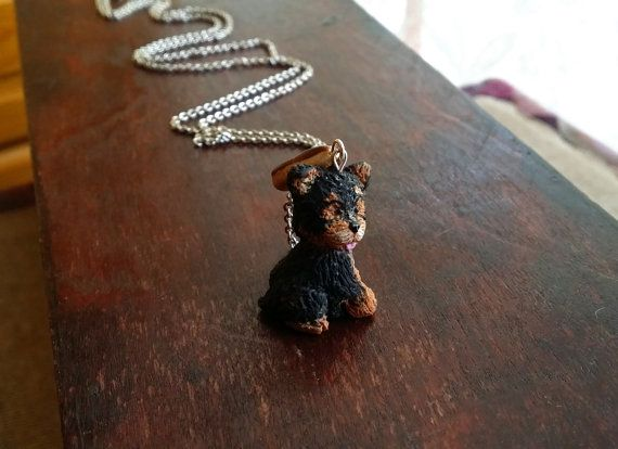 Check out this item in my Etsy shop https://www.etsy.com/listing/241324161/yorkie-mini-polymer-clay-necklace