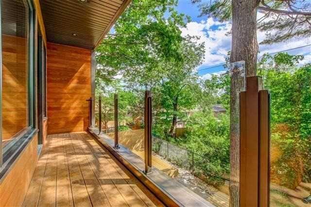 Contemporary Glass Railings, Balcony, Wood finish wall and floor