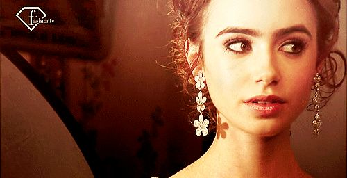 lily collins eyebrows smiling gif