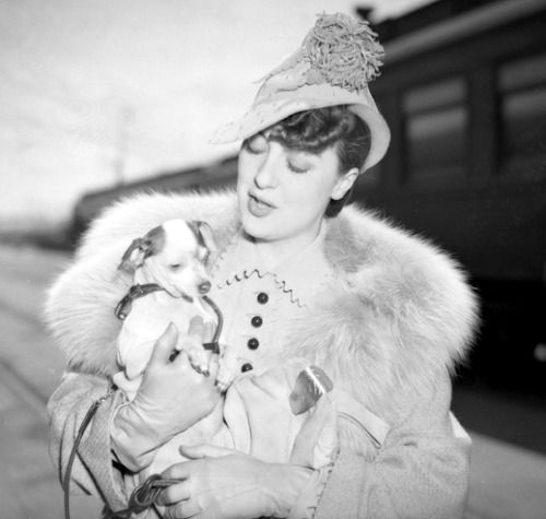 "silentcuriosity: "" Gypsy Rose Lee carrying dog at train station, circa 1937 Gypsy Rose Lee (January 9, 1911 – April 26, 1970) was an American burlesque entertainer famous for her striptease act. She was also an actress, author, and playwright whose..."