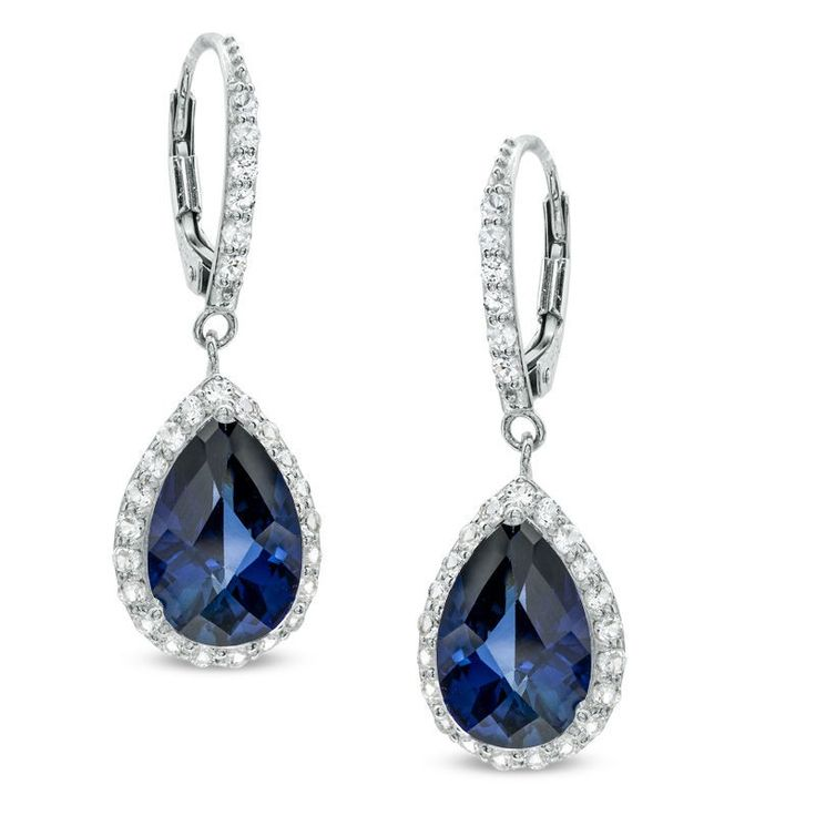 Elegant and dramatic, these exquisite drop earrings will win the heart of the September-born birthday girl. Created in sterling silver, the eye is drawn to the 12.0 x 8.0mm pear-shaped lab-created blue sapphire center stones, each bordered with a halo frame of shimmering round white sapphire accents. Additional white sapphires line the earring's front. Polished to a brilliant shine, these dazzling drops suspend from and secure with lever backs.
