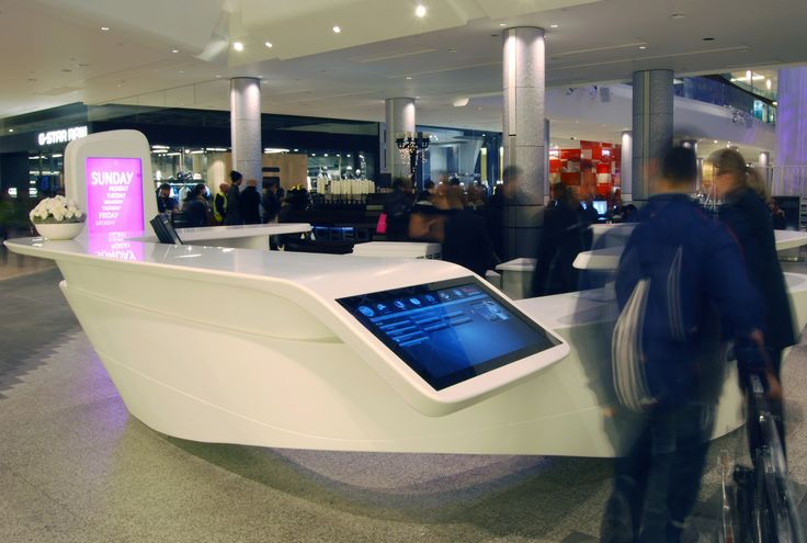 The studio used Corian across the product range to develop a light, fluid visual language that complemented the surrounding landscape of the shopping centre. More important, the sculptural forms integrate information and digital screens at various heights, to cater for all shoppers, including those with mobility and visual impairments.