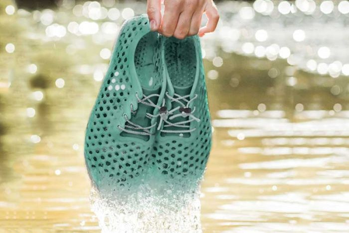 "The VIVOBAREFOOT x Bloom running shoes will be the first made entirely of algae-EVA foam. They offer an alternative to the petroleum-based foam that's found in almost every other running shoe on the market.  U.S.-based bio-material producer Bloom culls algae from freshwater sources like lakes, rivers, and ponds around the world. The brand then mixes it with EVA (ethylene vinyl acetate) to make a pliable, cushiony material.  The resultant algae-foam will, according to Bloom, ""meet or exceed…"