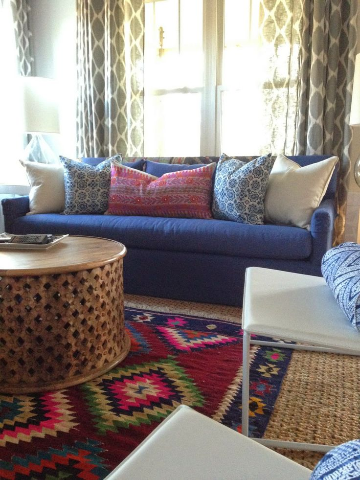 Love the funky rug and blue couch. fun and funky