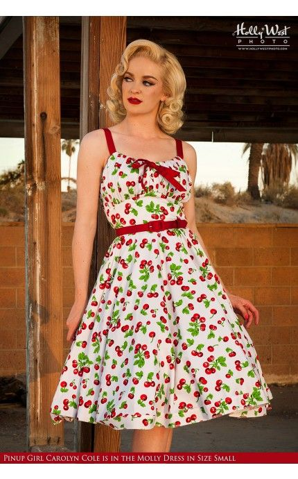 The Molly Dress: This cute dress had adjustable straps for the perfect fit, a gathered bodice that flatters a range of bust sizes, and a bow tie at the neckline that can be drawn in or loosened depending on your desired look. The full swing skirt comes complete with side pockets. Available here in this retro white cherry print! - See more at: http://www.pinupgirlclothing.com/molly-dress-white-cherry.html#sthash.QxY1fqHl.dpuf