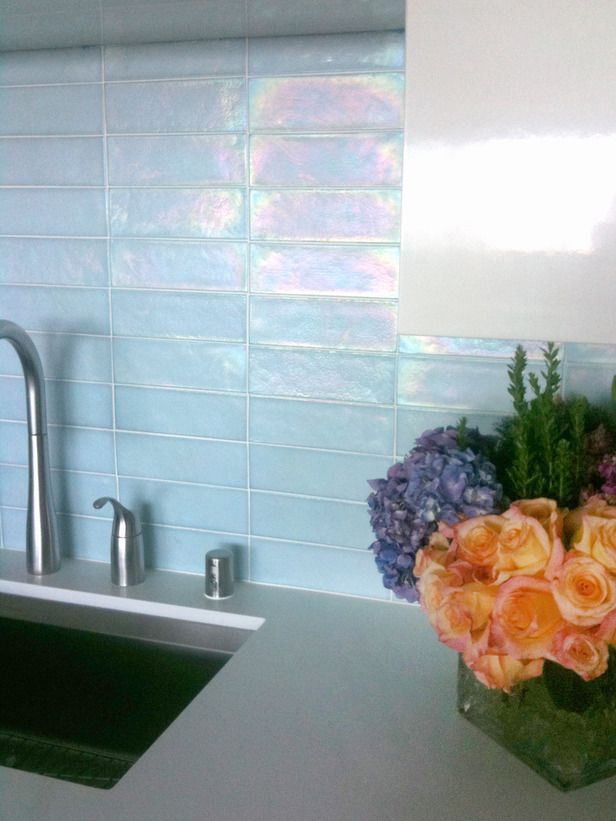 I think the glass tile backsplash will lighten up the kitchen when we remodel it.  This color is very pretty and clean.