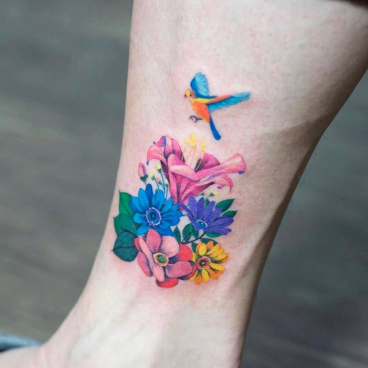 Colorful flower bouquet tattoo.