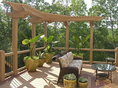 L-shaped wrap around deck trellis give your outdoor deck a custom design look.