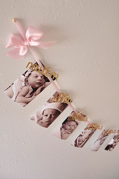"Confetti Momma's monthly photo banner can be the perfect way to show off all of your baby's photos from their first year of life! This garland has such a sophisticated look and you won't find one like it anywhere else but here! It comes pre strung so all you have to do is clip your 4x6 photos to it. This garland was designed with luxurious baby pink satin ribbon and includes glitter gold wording clipped on by tiny wooden clothespins that reads ""newborn"" ""one moth"" ""two months"" ""three ..."