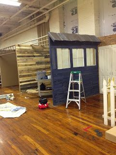 antique booth construction- framing wall for kids side of store