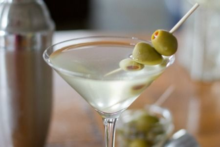 Dirty Martini! Gin is the classic base spirit, but you can go for vodka, the choice is all yours. Main thing is – make it DAMN COLD.  75ml of good quality gin (or vodka)  8ml of dry Martini  10ml of olive brine (the more brine, the dirtier it is)  Olives to garnish  Method: Pre-chill your bar equipment and ingredients. Once it's TOTALLY chilled, add the ice to the shaker and measure in the gin, brine and vermouth. Stir and strain into your chilled glass and garnish with olives. Mmmmm filthy!