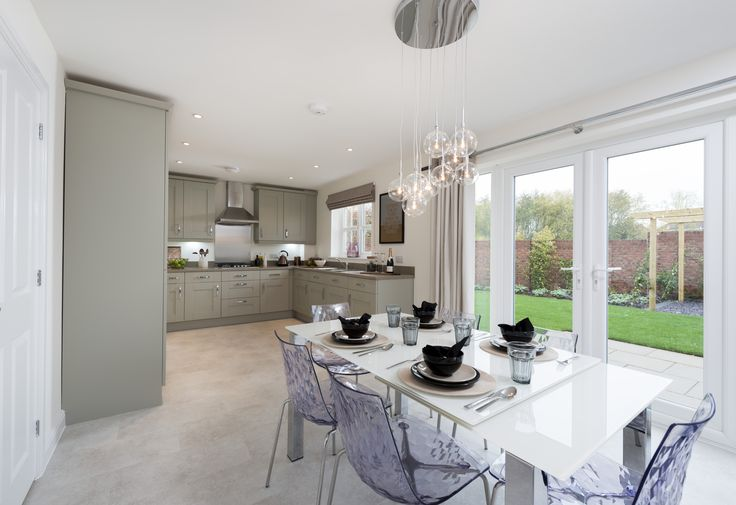 This lovely open-plan kitchen / diner is flooded with light from the French doors which lead onto the patio for al fresco dining in warmer months.