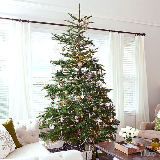 Glittering garlands, sparkling ornaments, and light-catching baubles create a tree worthy of center stage. By keeping the colors of the trimmings contained to gold, white, and clear, your tree will look fancy and still be easy to decorate./
