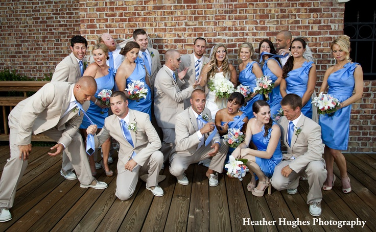 Funny bridal party portrait by Heather Hughes Photography. Blue dresses and khaki suits.