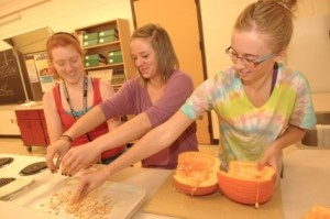"""The 22 students in the Food in the World Inquiry class started bonding in their freshman Orientation club. Their Hands for Change project was working at a food pantry. Now, they've become a cohesive group who is exploring firsthand how to become """"responsibly engaged in the world."""": 22 Student, Pumpkin Patches"""