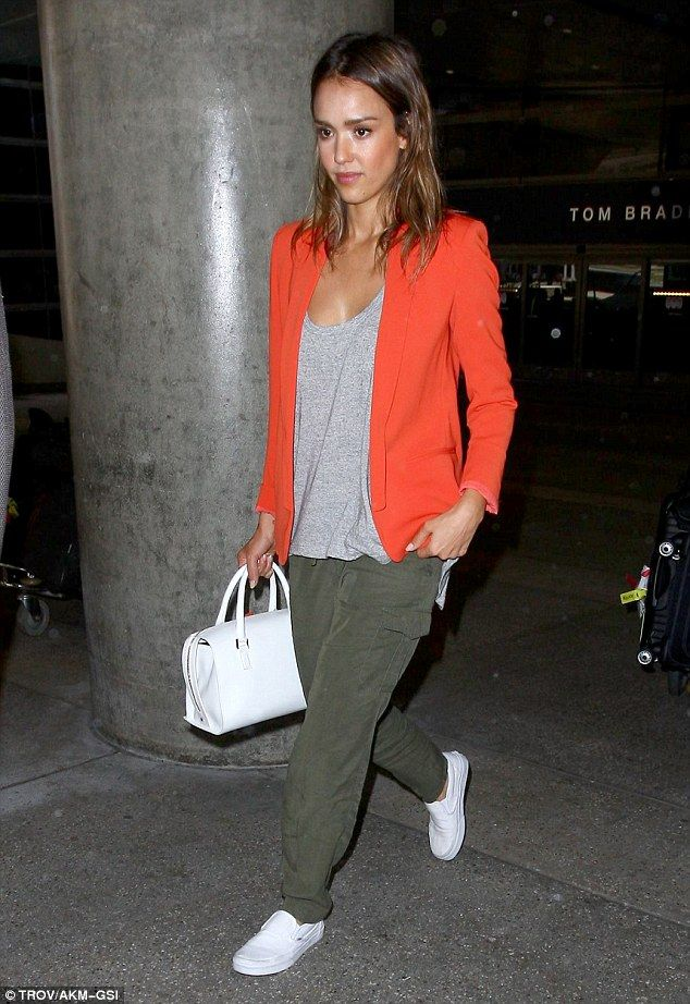 Jessica Alba livened up her baggy green trousers and white slip ons with a bright orange jacket at LAX http://dailym.ai/1q9E5Fv