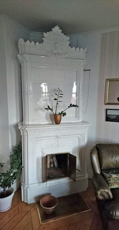 Very attractive all white rectangular tiled stove with a mantelpiece. Made by the Rörstrand Factory in Stockholm circa 1895. For a corner installation.