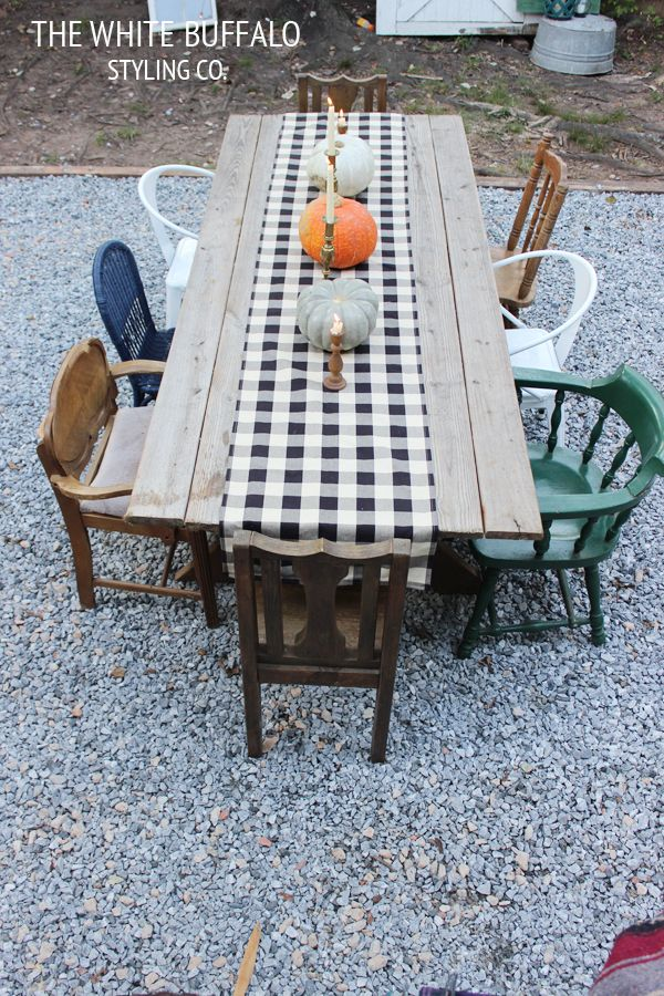 Simple Fall Decor for Outdoor Dining: Buffalo Check and a Variety of Pumpkins.