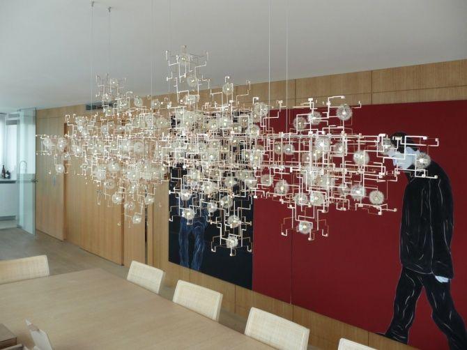 Real dandelions on this chandelier by Lonneke Gordijn and Ralph Nauta.