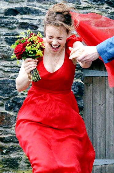 Rachel McAdams wore red for a wedding scene in About Time in Cornwall, England July 19.