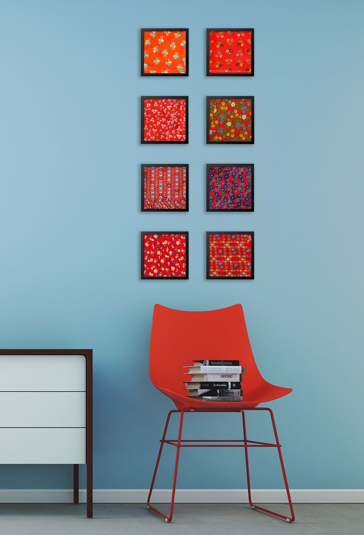 8 pieces of red artwork - accent in a blue room