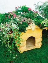 Готовая конура с цветочной крышей