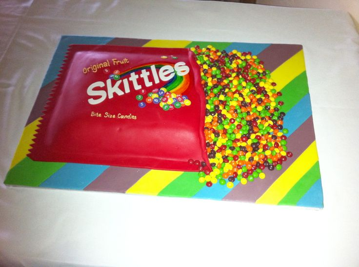 """This cake was so much fun to make! It is a lemon cake with lemon buttercream icing but covered in fondant. I used to the Cricut Cake to cut out the 'Skittles"""" letters. Fondant on the board of course. Real skittles dumped out on the board. Groom's favorite candy. They also had packages of skittles scattered around the tables."""
