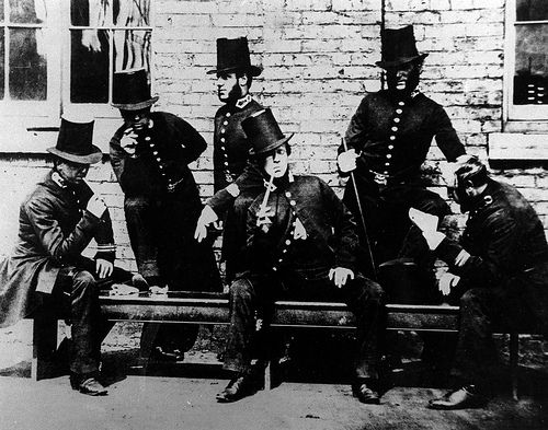 Manchester Police peelers relaxing photographed around 1840. This is one of the very earliest images of policing in the Greater Manchester Area. The foundation of British policing was greatly influenced by some-time Home Secretary and Prime Minister, Sir Robert Peel. Sir Robert was born in Bury, now part of the Greater Manchester region. From the collection of the Greater Manchester Police Museum and Archives. To find out more please visit http://www.gmpmuseum.com