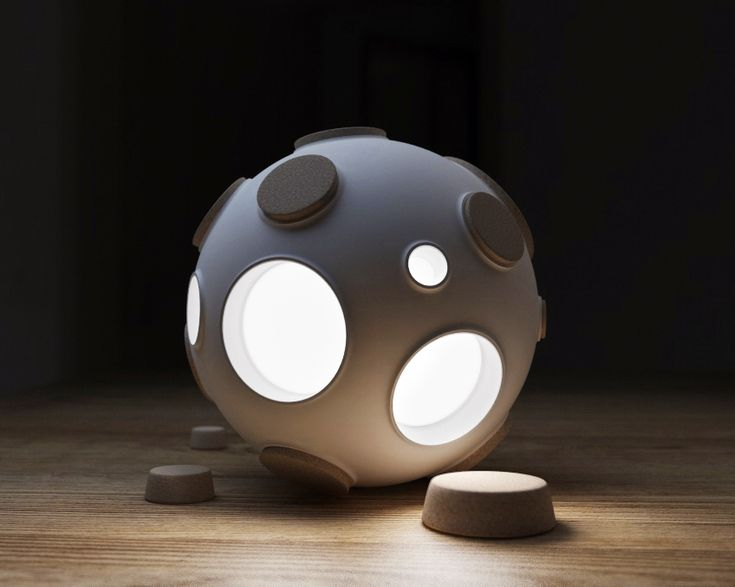 "The Armstrong is a lamp with a clever spherical form inspired by the moon. The lamp operates in a most unusual way--it only turns on and emits light when one of the corked ""craters"" is opened, reve..."