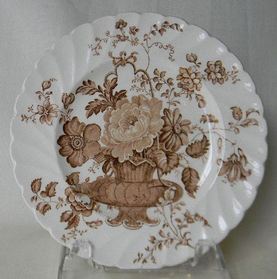STUNNING VINTAGE, ENGLISH, BROWN TRANSFERWARE PLATE CHARLOTTE BASKET OF FLOWERS Royal Staffordshire I absolutely love this pattern! It is called Charlotte and is made by Clarice Cliff of Royal Staffor