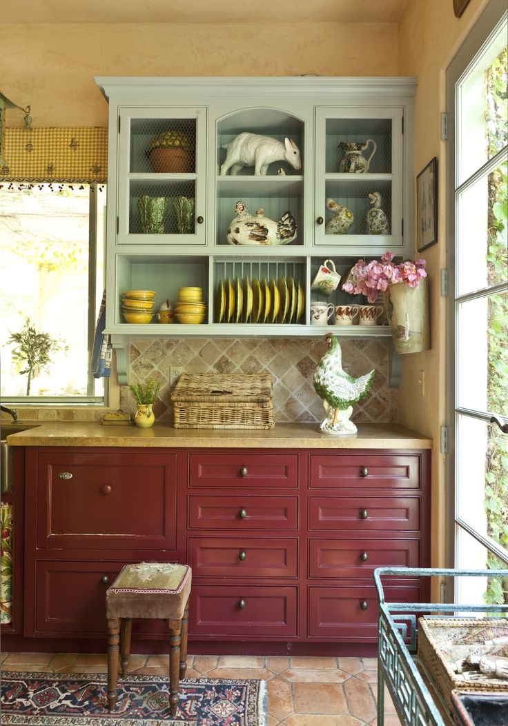 French Country Kitchen - love the fact that the top cabinet is painted a different cupboard to the chest-of-drawers beneath - I like the unexpected!
