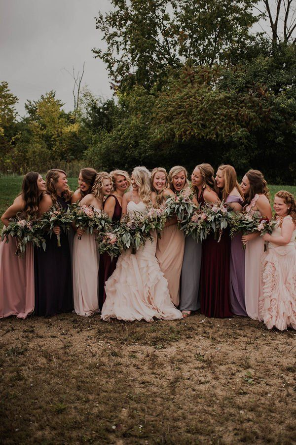bridal party in mismatched bridesmaid dresses