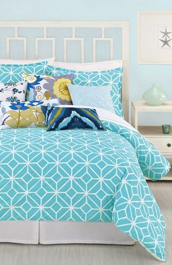 Loving this modern bedroom. The colors and patterns are really great!