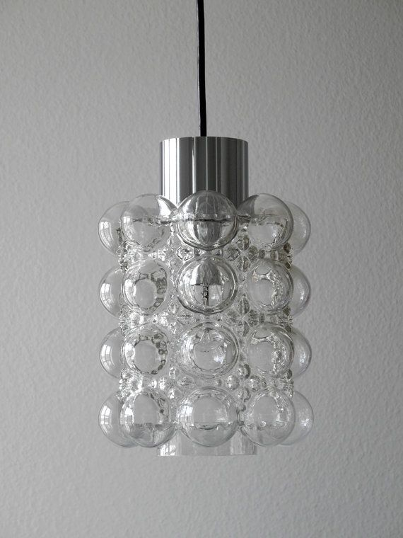 Big and heavy original clear glass Bubble pendant lamp from the 60s. Manufactured by Limburg Design by Helena Tynell. Very good vintage condition with little traces of use and fully functional. 100% original condition without damage and fully functional. The glass has no damage, no scratches or flaking. Very warm, shiny and beautiful light. Suitable for all living areas and very decorative. Height glass shade: 24 cm / 9.45 Diameter glass shade: 20 cm / 7.9 Total height with cable: 100 cm…