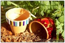 """The Toad Abode """" Why are toads so happy? They eat whatever bugs them!"""" How too fun for the kids wonderful and so pretty for the garden!! Love this site!  Two tiled pots"""