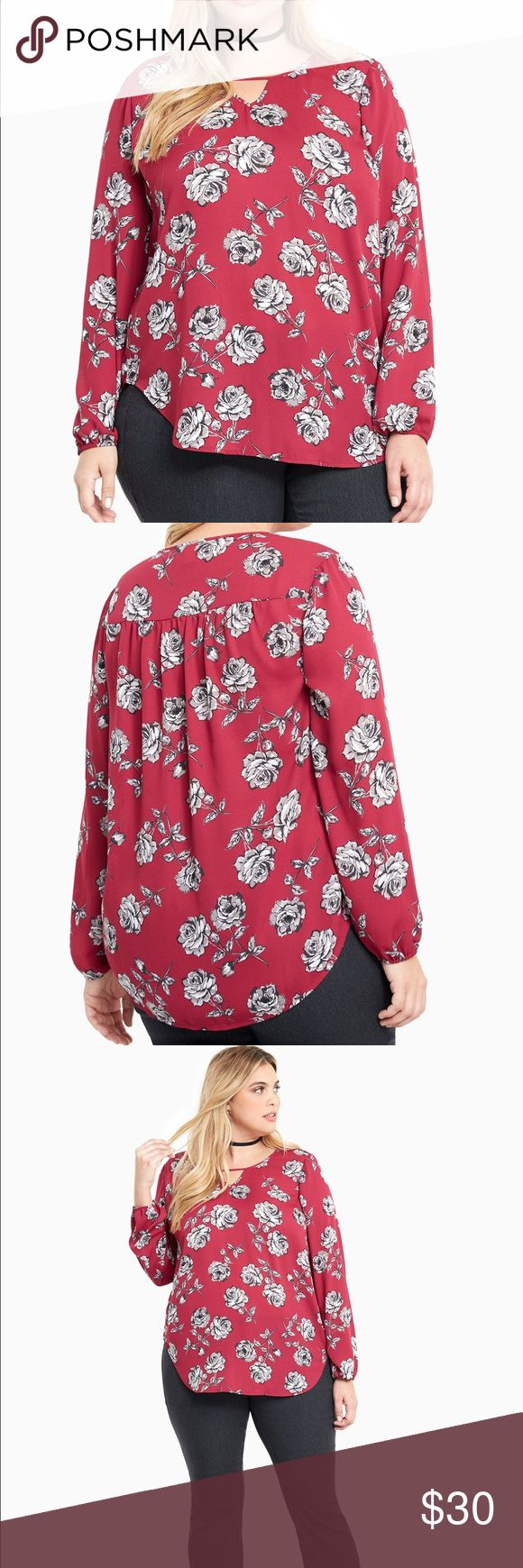 "Torrid Georgette Keyhole Floral Top 5 out of 5 stylists agree; this top guarantees that you'll be the best-dressed everywhere you go. The magenta georgette is totally flirty with a monochrome floral print, while the keyhole neck is sexy without becoming scandalous. The curved shirttail hem basically provides a wind machine everywhere you go. Model is 5'10"", size 1 Size 1 measures 31 1/4"" from shoulder. Polyester. torrid Tops Blouses"