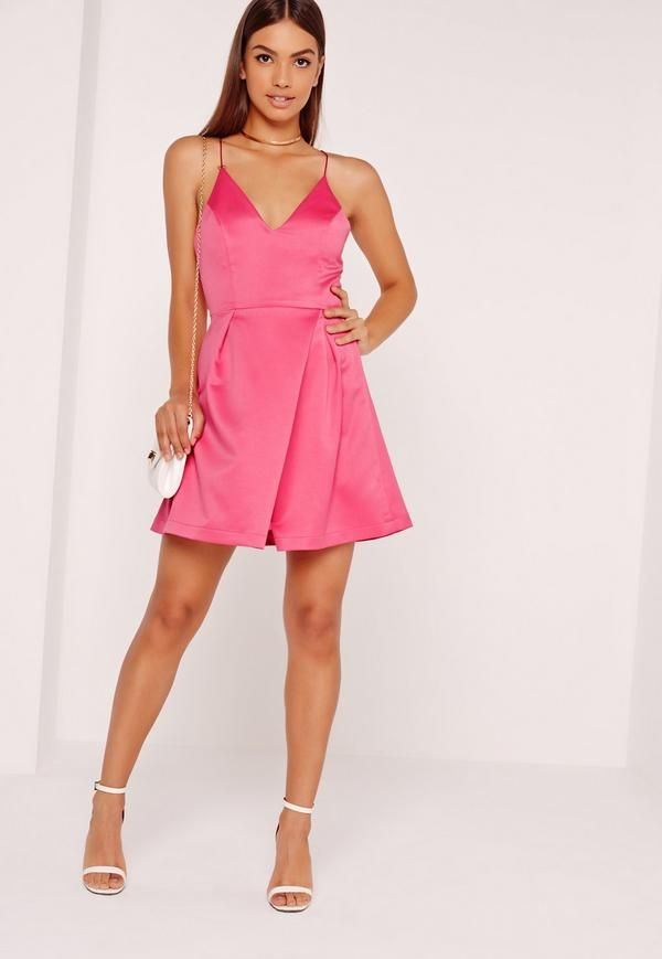 Time to update your go to party dress ladies, and this little beaut ticks all our boxes. This seriously strappy piece has our names written all over it! In standout pink, spaghetti straps and super silky to the touch, style with black barel...