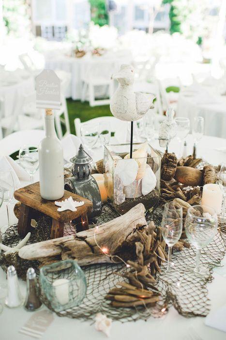 Centerpiece of mixed shells, net, driftwood and rocks . Source: carinaskrobeciblog.com #beachweddings #centerpieces  #nautical