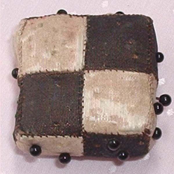Tiny checked antique silk pincushion.