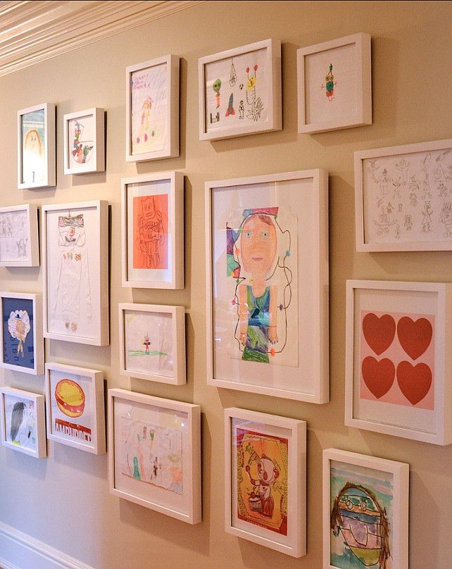 display your kids art organized on the wall in frames