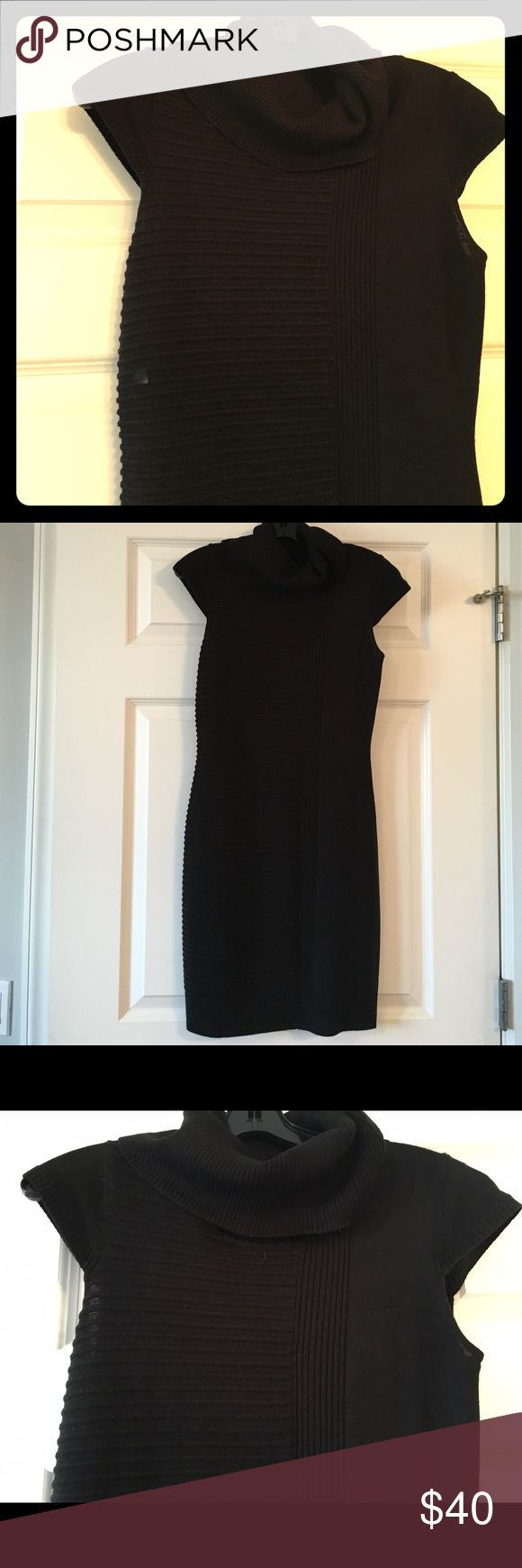Marc New York by Andrew Marc sweater dress ❄️NOW $24❄️Marc New York by Andrew Marc Black turtle neck cap sleeve sweater dress with ribbed details.Great to wear with tights and booties. Dress it up or down. Andrew Marc Sweaters Cowl & Turtlenecks